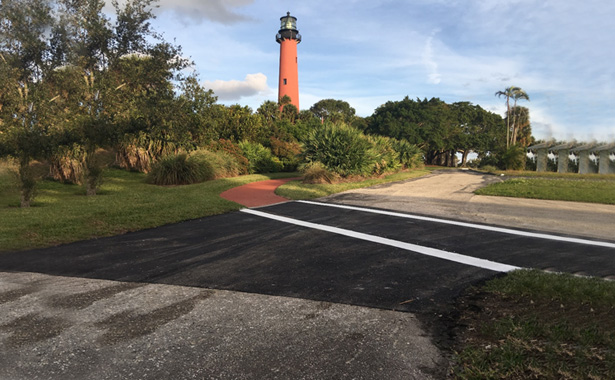 asphalt with lighthouse in the background